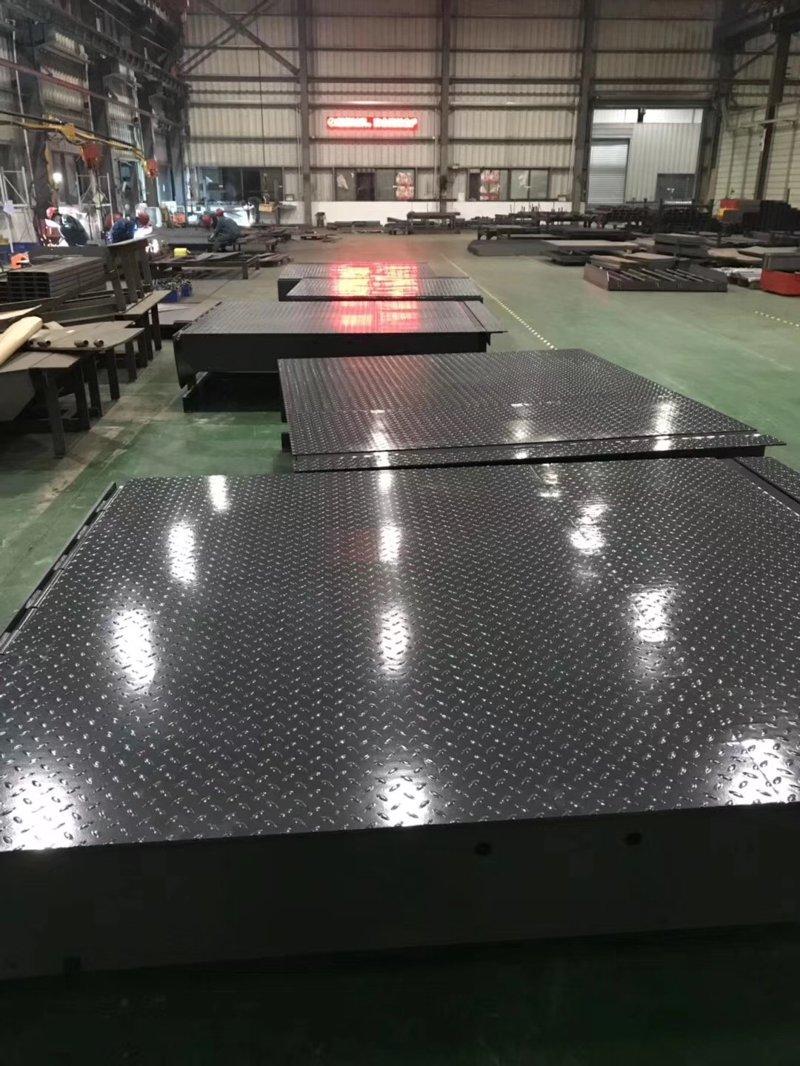 卸货平台厂家打造静电喷塑+190°高温烘烤处理!
